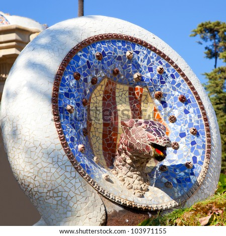 Barcelona Park Guell of Gaudi Snake and four Catalan bars in modernism mosaic
