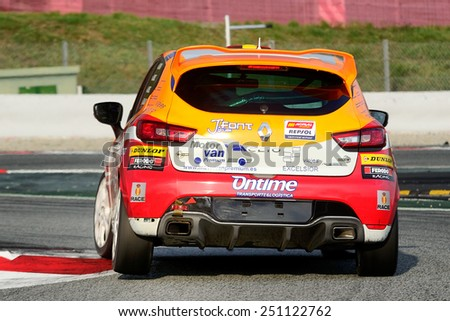 BARCELONA, SAPIN - SEP 7: Team formed by Jose M Alonso, Javier Hernandez, and Jaime Font races in a Renault Clio in the 24 Hours of Barcelona, at Catalunya Circuit, on Sep 7, 2014 in Barcelona, Spain