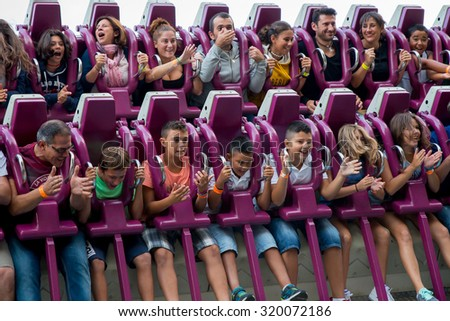 BARCELONA - SEP 5: People have fun at the Drop Tower attraction at Tibidabo Amusement Park on September 5, 2015 in Barcelona, Spain. - stock photo
