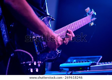 BARCELONA - SEP 21: The guitar electric player of Viento Smith (band) peformance at Barcelona Accio Musical (BAM) La Merce Festival on September 21, 2014 in Barcelona, Spain. - stock photo