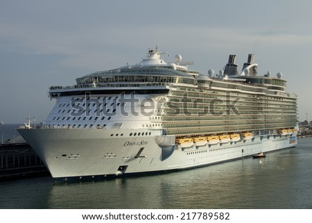 BARCELONA - SEP, 13: The Largest cruise ship Oasis of the Seas docking in a Barcelona port, the most important cruiser port in the mediterranean sea, Septembre 13, 2014 in Barcelona, Spain - stock photo