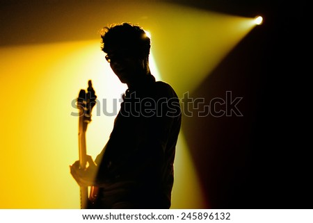 BARCELONA - SEP 24: The silhouette of the guitarist of We are Standard (band) performs at Discotheque Razzmatazz on September 24, 2010 in Barcelona, Spain.                  - stock photo