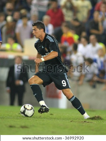 BARCELONA - SEPT. 12: Cristiano Ronaldo of Real Madrid in action during a Spanish League match against RCD Espanyol at the Estadi Cornella-El Prat on September 12, 2009 in Barcelona, Spain - stock photo