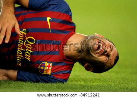 BARCELONA -  SEPT 17: Javier Mascherano of FC Barcelona injured during the spanish league match against Osasuna at the Nou Camp Stadium on September 17, 2011 in Barcelona, Spain - stock photo