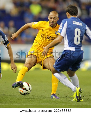 BARCELONA - SEPT, 20: Nordin Amrabat of Malaga CF in action during a Spanish League match against RCD Espanyol at the Estadi Cornella on September 20, 2014 in Barcelona, Spain - stock photo