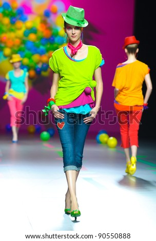 BARCELONA – SEPTEMBER 17: A model walks on the Agatha Ruiz de la Prada catwalk during the Cibeles Madrid Fashion Week runway on September 17, 2011 in Barcelona, Spain. - stock photo