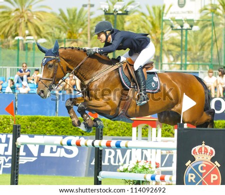 BARCELONA - SEPTEMBER 21: Angelica Augustsson in action during the CSIO 101th International jumping competition in Real Club Polo Barcelona, on September 21, 2012, Barcelona, Spain.