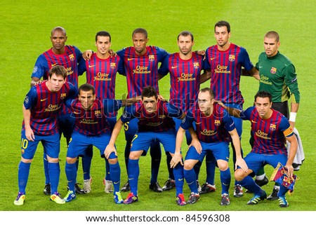 BARCELONA - SEPTEMBER 13: Barcelona players before the Champions League match between FC Barcelona and AC Milan, final score 2 - 2, on September 13, 2011, in Camp Nou stadium, Barcelona, Spain. - stock photo