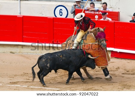 "BARCELONA - SEPTEMBER 24: ""Corrida"" (bullfight) of bulls, typical Spanish tradition where a torero (bullfighter) kills a bull. September  24, 2011 in Barcelona (Spain). - stock photo"