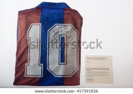 BARCELONA - SEPTEMBER 22, 2014: Diego Armando Maradona football shirt at the FC Barcelona museum. Camp Nou, Barcelona, Spain. - stock photo