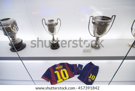 BARCELONA - SEPTEMBER 22, 2014: Football shirt and shorts of Lionel Messi. One of the trophy galleries at the FC Barcelona museum. Camp Nou, Barcelona, Spain. - stock photo