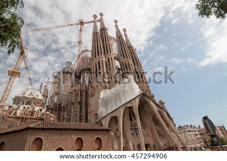 BARCELONA - SEPTEMBER 20, 2014: Sagrada Familia - Basilica and Expiatory Church of the Holy Family is a large Roman Catholic church in Barcelona, designed by Antoni Gaudi. Barcelona, Catalonia, Spain. - stock photo