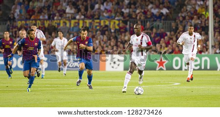 BARCELONA - SEPTEMBER 13: Some players in action at the Champions League match between FC Barcelona and Milan, final score 2 - 2, on September 13, 2011, in Camp Nou stadium, Barcelona, Spain. - stock photo