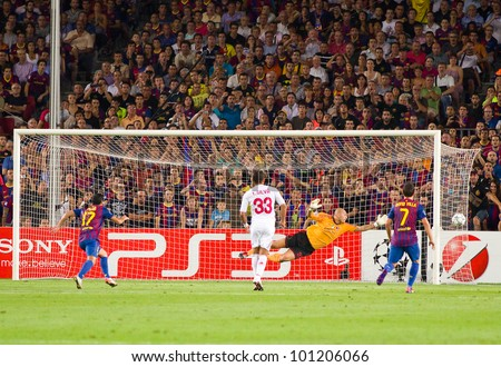BARCELONA - SEPTEMBER 13: Some players in action during the Champions League match between FC Barcelona and AC Milan, final score 2 - 2, on September 13, 2011, in Camp Nou, Barcelona, Spain. - stock photo