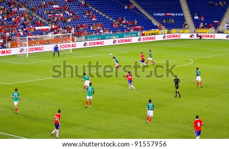 BARCELONA - SEPTEMBER 4: Some players in action during the friendly match between Mexico (green shirt) and Chile, final score 1 - 0, on September 4, 2011, in Cornella stadium, Barcelona, Spain. - stock photo