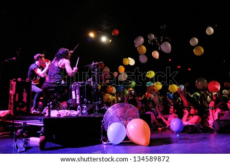 BARCELONA, SPAIN - APR 2: Matt and Kim, energetic indie pop couple surrounded by colorful balloons launched by the audience, performs at Apolo on April 2, 2011 in Barcelona, Spain.