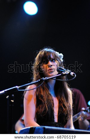 BARCELONA, SPAIN - APR 25: Zooey Deschanel, Hollywood Actress and singer, performs with her band She & Him at Apolo on April 25, 2010 in Barcelona, Spain. She perfoms with Matt Ward. - stock photo