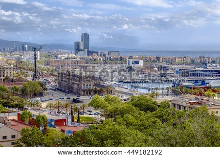 Barcelona, Spain - April 21, 2013: Panoramic of Barcelona port area wadis and detail of the statue of Christopher Columbus