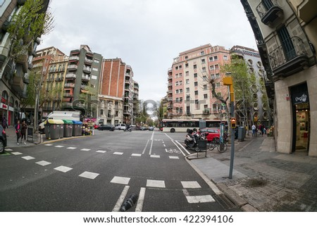 Barcelona, Spain - April 04, 2016:People cross the avenue in downtown April 04, 2016, 2013. Barcelona is a Spanish city, capital of the autonomous community of Catalonia.                     - stock photo