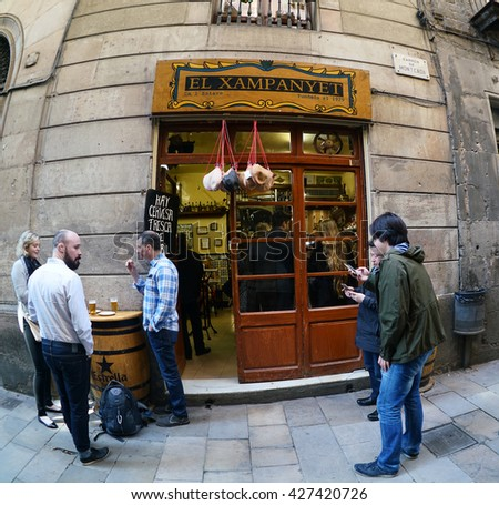 Barcelona, Spain - April 07, 2016:People driking beer  and eating snack food on April 07, 2016. El Born is a trendy area in Barcelona that has become a major tourist attraction.  - stock photo