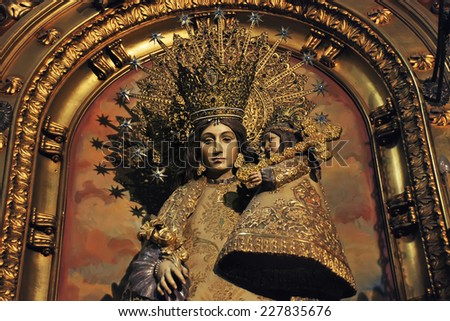 BARCELONA, SPAIN - APRIL 6, 2013: Religious sculpture of Mother Mary wearing a golden crown with a child made inside one of the churches in the city