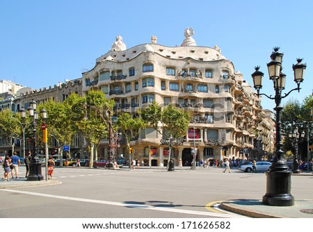 BARCELONA, SPAIN - AUGUST 12: Casa Mila on August 12, 2011 in Barcelona, Spain. This famous building was designed by Antoni Gaudi, included in the list of UNESCO. - stock photo