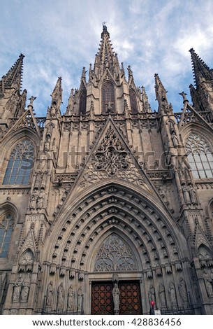 BARCELONA, SPAIN - AUGUST 3, 2015: Exterior facade of the Cathedral of the Holy Cross and Saint Eulalia (known as Barcelona Cathedral). This gothic cathedral is a seat of the Archbishop of Barcelona.