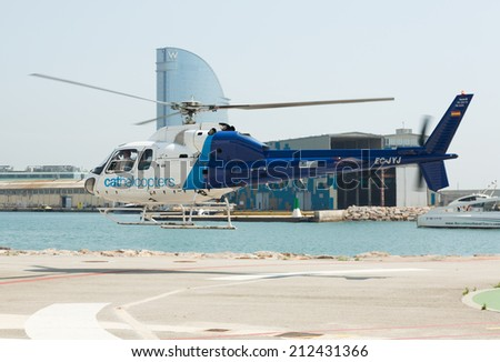BARCELONA, SPAIN - AUGUST 1, 2014: Flying helicopters of Helicopters tours company. Barcelona, Spain