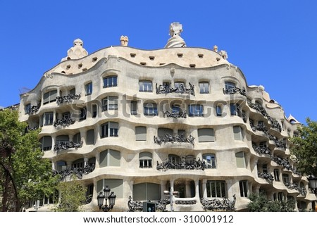 BARCELONA, SPAIN - AUGUST 9, 2015: La Pedrera building in Barcelona. It is also known as Casa Mila, was designed by Antoni Gaudi and has been a UNESCO site since 1984.  - stock photo
