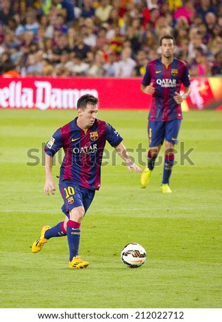 BARCELONA, SPAIN - AUGUST 18: Leo Messi of FCB in action at Gamper friendly match between FC Barcelona and Club Leon FC, final score 6-0, on August 18, 2014, in Camp Nou, Barcelona, Spain. - stock photo