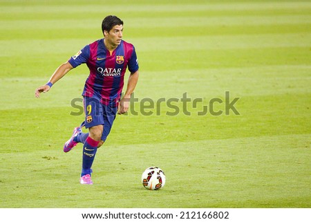 BARCELONA, SPAIN - AUGUST 18: Luis Suarez of FCB in action at Gamper friendly match between FC Barcelona and Club Leon FC, final score 6-0, on August 18, 2014, in Camp Nou, Barcelona, Spain. - stock photo
