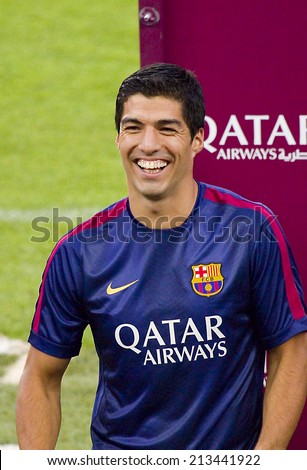 BARCELONA, SPAIN - AUGUST 18: Luis Suarez presentation in front of the home supporters before Gamper match between FC Barcelona and Club Leon, 6-0, on August 18, 2014, in Camp Nou, Barcelona, Spain. - stock photo