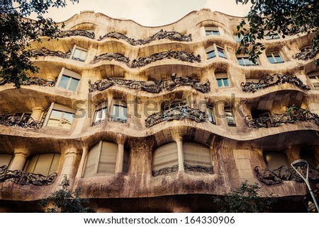 BARCELONA, SPAIN - AUGUST 24: Modernism style architecture. Casa Mila aka La Pedrera (Catalan for 'The Quarry') on August 24 2012. This house was built during 1906 - 1910.