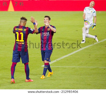 BARCELONA, SPAIN - AUGUST 18: Neymar Junior and Leo Messi celebrating a goal at Gamper friendly match between FC Barcelona and Club Leon FC, 6-0, on August 18, 2014, in Camp Nou, Barcelona, Spain. - stock photo