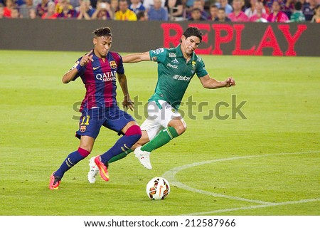 BARCELONA, SPAIN - AUGUST 18: Neymar Junior of FCB (L) in action at Gamper friendly match between FC Barcelona and Club Leon FC, final score 6-0, on August 18, 2014, in Camp Nou, Barcelona, Spain. - stock photo