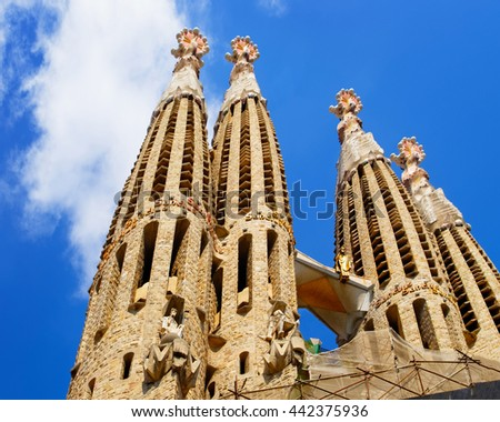 BARCELONA, SPAIN - AUGUST 14, 2011: Spires of Sagrada Familia in Barcelona in Spain. It is called in English as Basilica and Expiatory Church of Holy Family. It was designed by Antoni Gaudi - stock photo