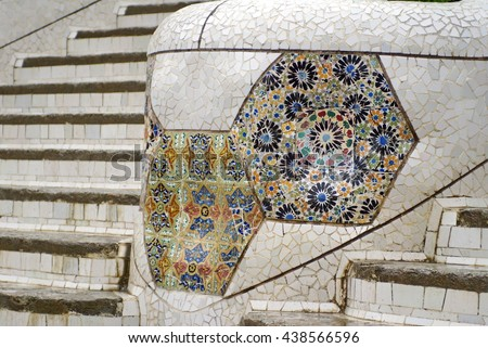 BARCELONA, SPAIN - CIRCA NOVEMBER 2013: Tile mosaic decorations on a small wall surrounding a staircase in Park Guell