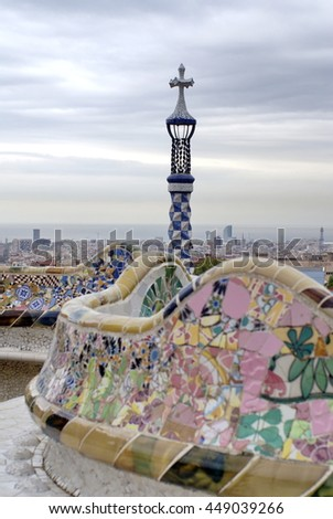 BARCELONA, SPAIN - CIRCA OCTOBER 2013: Tile mosaic terrace with a tiled tower in Park Guell