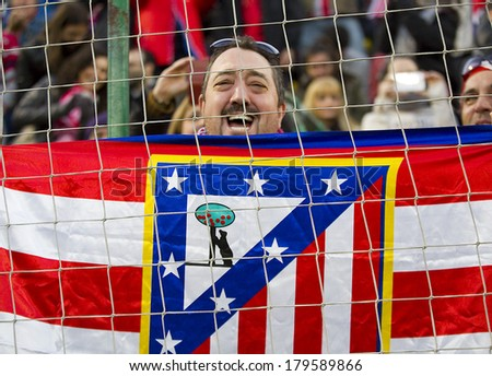 BARCELONA, SPAIN - DECEMBER 7: Atletico unidentified supporters at Spanish Cup match between Sant Andreu and Atletico de Madrid, final score 0-4, on December 7, 2013, in Barcelona, Spain. - stock photo