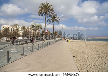 BARCELONA,SPAIN-DECEMBER 9,2015: Beach of Barceloneta and promenade maritime, Barcelona.