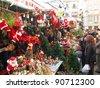 BARCELONA, SPAIN - DECEMBER 11: Unidentified people visits the famous Santa Llucia Festival to buy Christmas decoration, as pines trees and crib figures, on December 11, 2011, in Barcelona, Spain. - stock photo