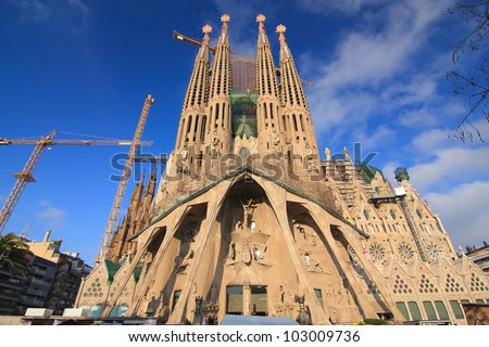 BARCELONA, SPAIN - FEBRUARY 25: Sagrada Familia on February 25, 2012: La Sagrada Familia - the impressive cathedral designed by Gaudi, which is being build since 19 March 1882 and is not finished yet. - stock photo