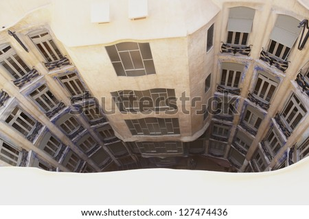 BARCELONA, SPAIN - JANUARY 24: Antoni Gaudi's work at the roof of Casa Mila onJanuary 24, 2013 in Barcelona, Spain. Popularly known as La Pedrera, this modernist house was built between 1906 and 1910. - stock photo