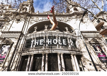 Barcelona, Spain - January 28, 2015: Art installation of woman legs at the facade of the Cinema Coliseum  in Barcelona.