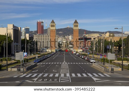 BARCELONA, SPAIN - JANUARY 10, 2016: City view of Barcelona, in Maria Cristina avenue, with the famous towers of Plaza Espana in the background, in the city of Barcelona, Spain on January 10, 2016