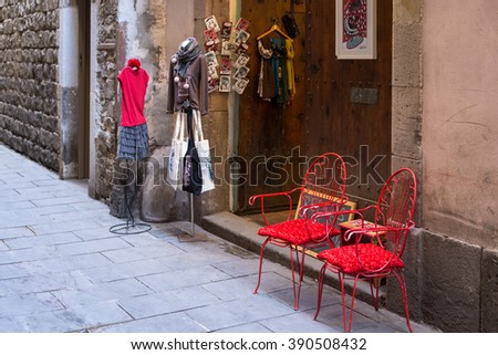 BARCELONA, SPAIN - JANUARY 21. Extraordinary boutiques, shops and stores where sell clothes and fashion, in the narrow streets of the El Born/La Ribera district of Barcelona on January 21, 2016 - stock photo