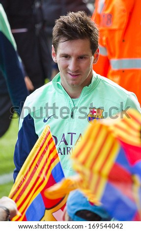 BARCELONA, SPAIN - JANUARY 3: Leo Messi signing autographs at FC Barcelona team in open doors training session at Mini Estadi stadium, with 13,200 spectators, on January 3, 2014, in Barcelona, Spain. - stock photo