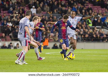 BARCELONA, SPAIN - JANUARY 27: Lionel Messi (10) of FCB in action at the Spanish League match between FC Barcelona and Osasuna, final score 5 - 1, on January 27, 2013, in Barcelona, Spain. - stock photo