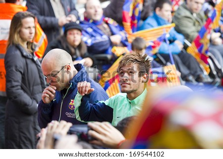 BARCELONA, SPAIN - JANUARY 3: Neymar Jr signing autographs at FC Barcelona team in open doors training session at Mini Estadi stadium, with 13,200 spectators, on January 3, 2014, in Barcelona, Spain. - stock photo