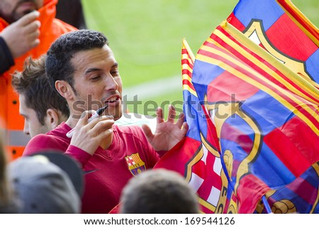 BARCELONA, SPAIN - JANUARY 3: Pedro signing autographs at FC Barcelona team in open doors training session at Mini Estadi stadium, with 13,200 spectators, on January 3, 2014, in Barcelona, Spain. - stock photo